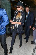 CHRISSY TEIGEN at Los Angeles International Airport 06/28/2015