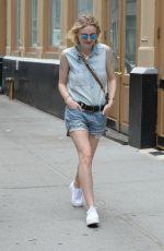 DAKOTA FANNING in Jeans Shorts Out in Soho 06/23/2015