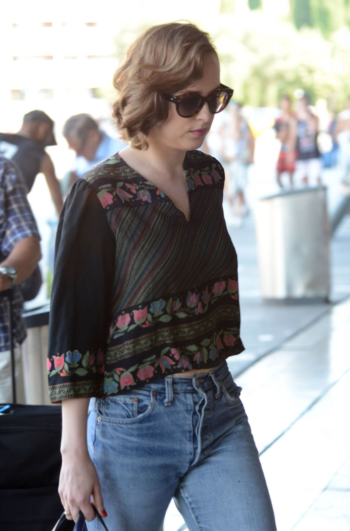 DAKOTA JOHNSON at Barcelona–el Prat Airport in Barcelona