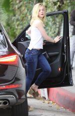 ELLE FANNINF in Jeans Arrives at Her Hotel