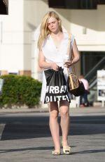 ELLE FANNING Leaves Urban Iutfiters in Los Angeles 06/26/2015