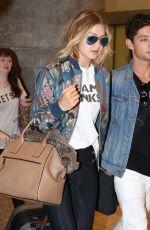 GIGI HADID Arrives at Airport in Toronto 06/20/2015