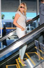 KATE UPTON at LAX Airport in Los Angeles 06/18/2015