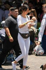 KENDALL JENNER at Disneyland for North West