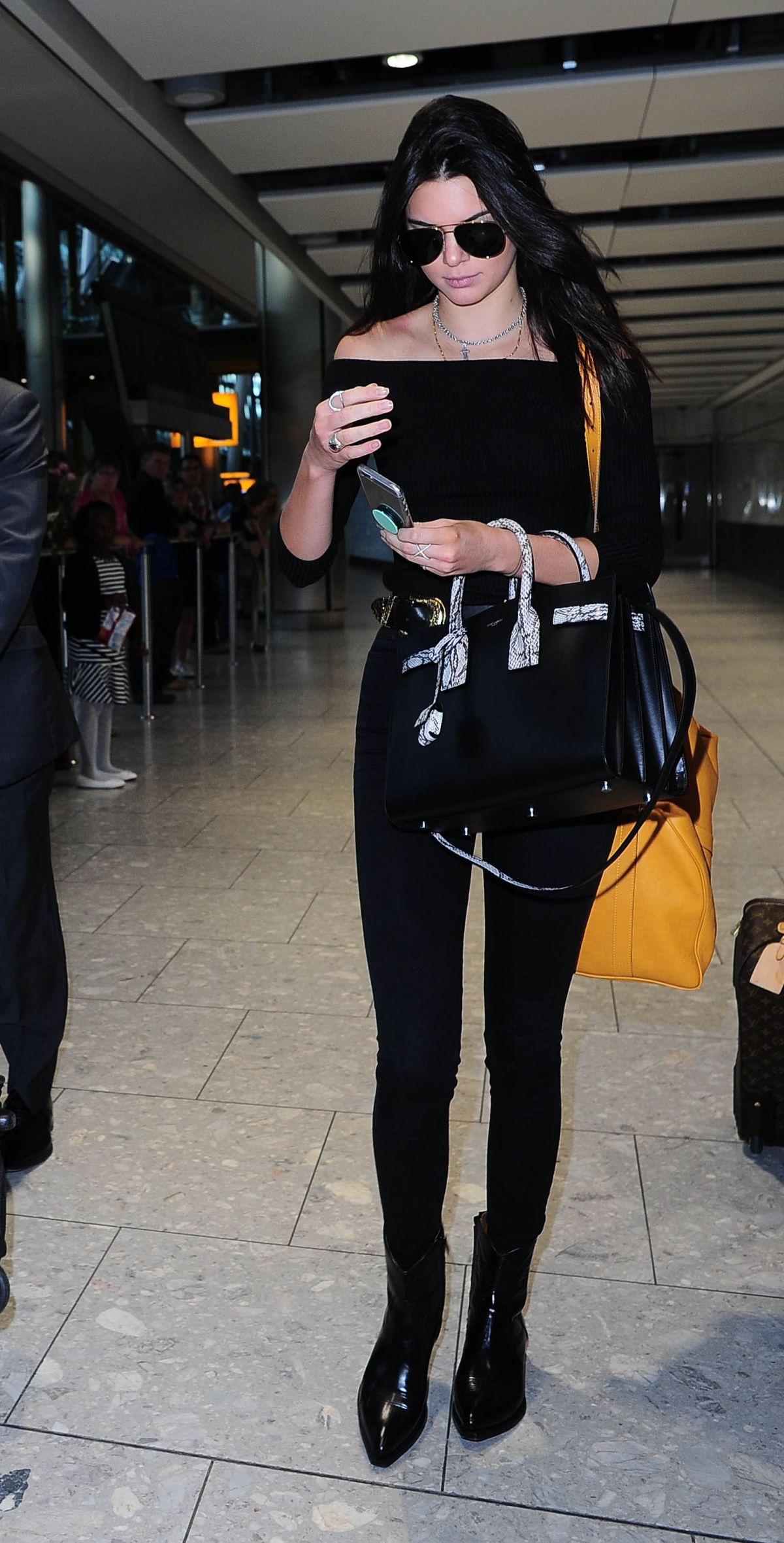 KENDALL JENNER at Heathrow Airport in London 06/27/2015