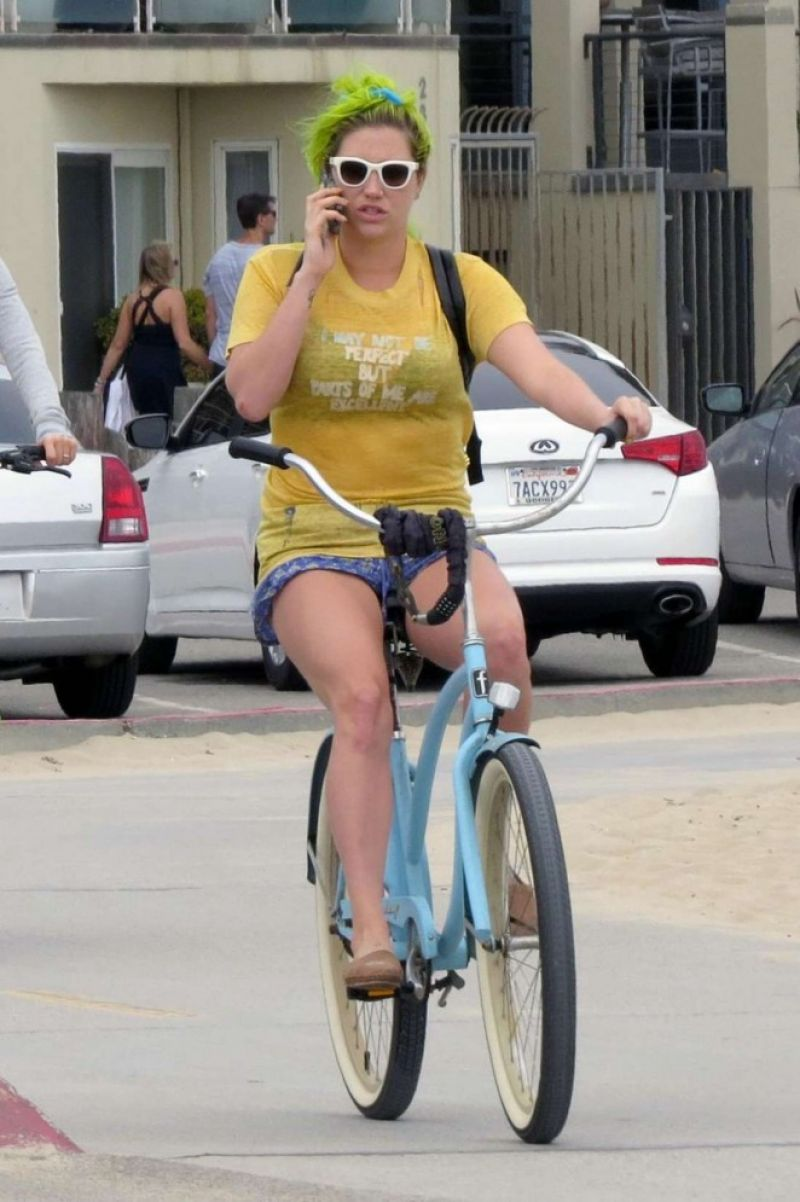 KESHA Riding a Bike Out in Los Angeles 06/15/2015