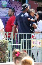 KYLIE JENNER at Disneyland for North West