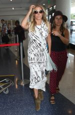 LEANN RIMES at Los Angeles International Airport 006/11/2015