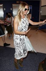 LEANN RIMMES at Los Angeles International Airport 06/11/2015