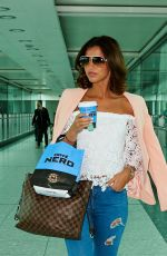 LUCY MECKLENBURGH at Heathrow Airport in London 06/01/2015