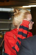 MARGOT ROBBIE Arrives at Heathrow Airport in London 06/26/2015