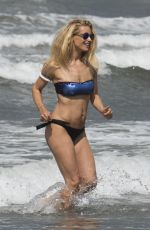 MICHELLE HUNZIKER in Bikini on Vocation at a Beach in Italy 06/16/2015