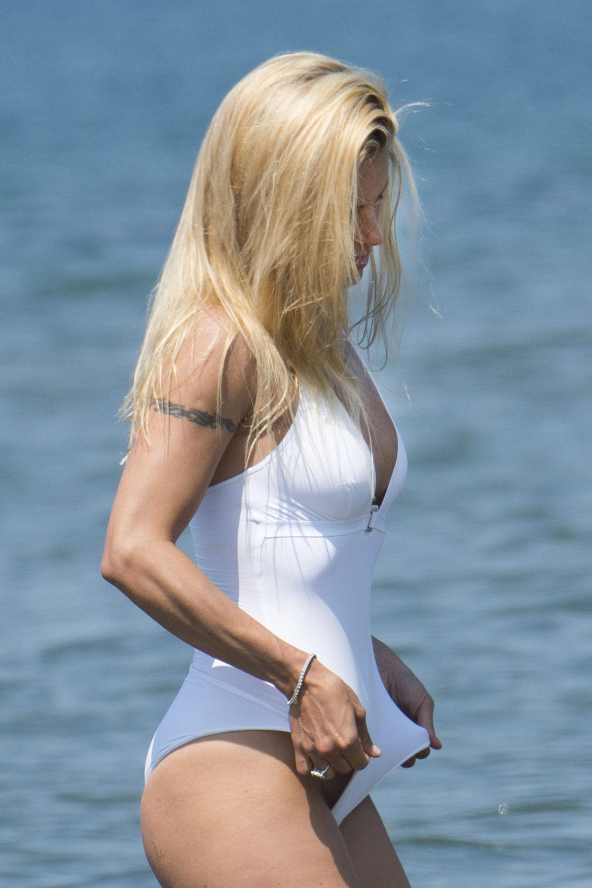 MICHELLE HUNZIKER in Swimsuit and Bikini at a Beach at Forte Dei Marmi