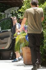 MILLA JOVOVICH in Leggings Out in West Hollywood 06/24/2015