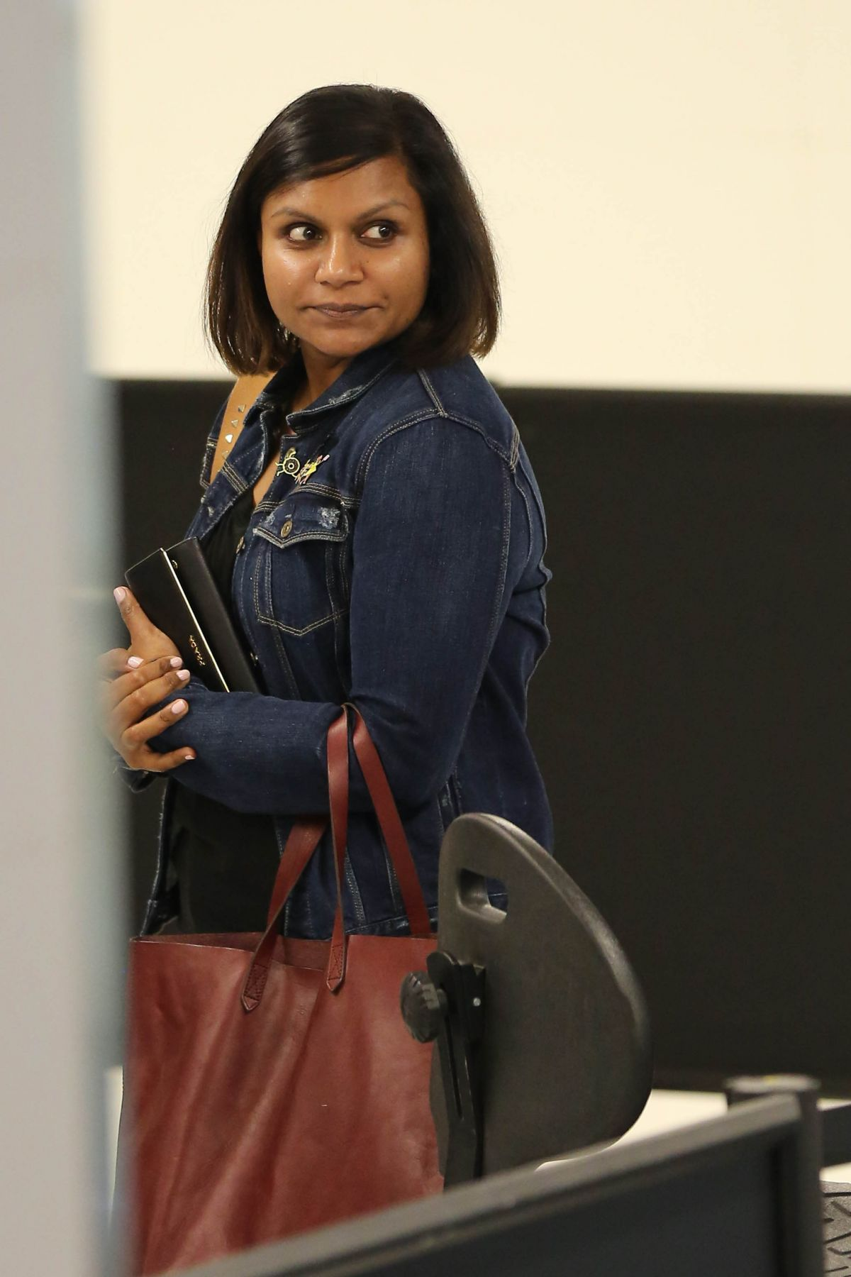 MINDY KALING at LAX Airport in Los Angeles 06/16/2015