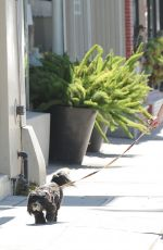 MIRANDA COSGROVE Walks Her Dog Out in Los Angeles 06/20/2015