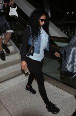 NICKI MINAJ Arrives at LAX Airport in Los Angeles 06/24/2015