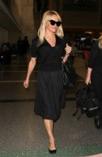PAMELA ANDERSON at LAX Airport in Los Angeles 06/16/2015