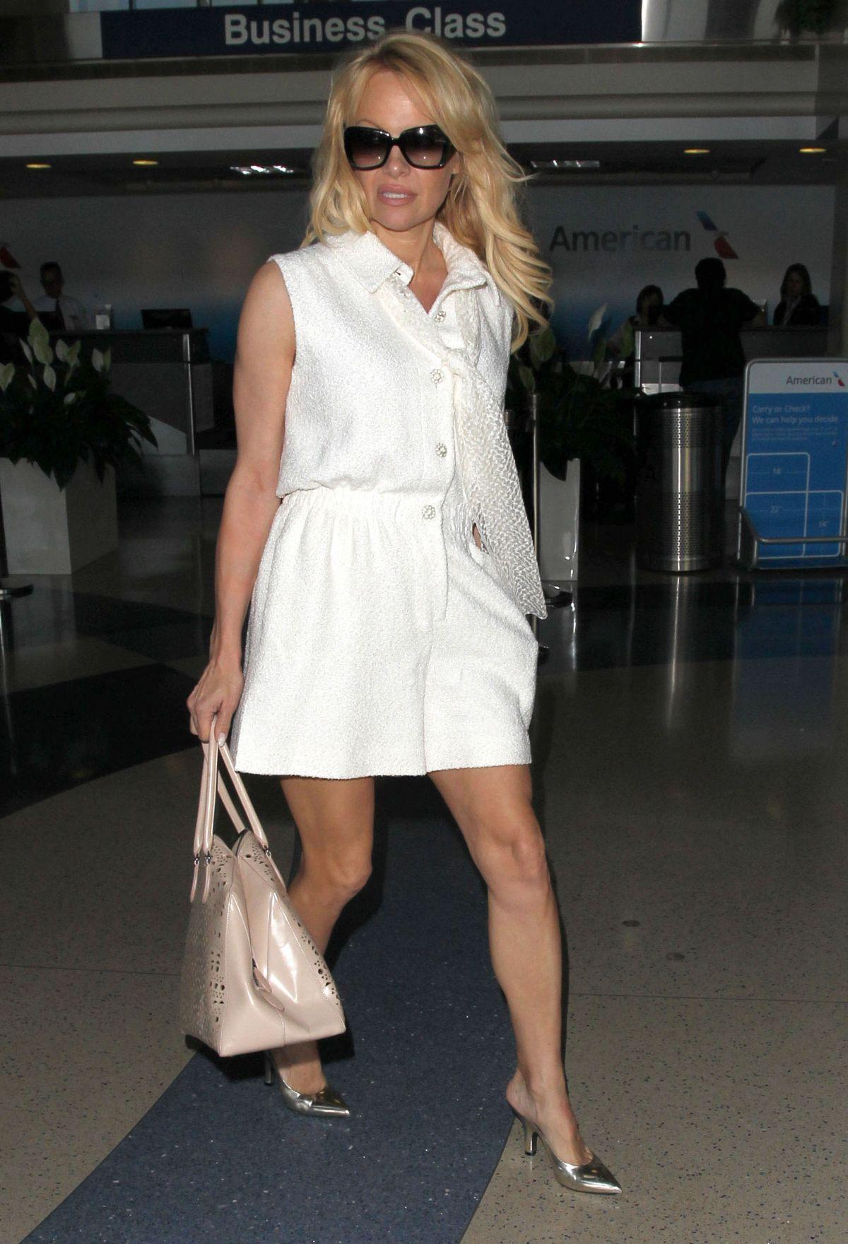 PAMELA ANDERSON at Los Angeles International Airport 06/12/2015
