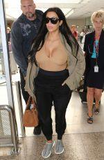 Pregnant KIM KARDASHIAN Arrives at Airport in Nice 06/23/2015