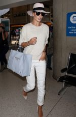 ROSIE HUNTINGTON-WHITELEY Arrives at LAX Airport in Los Angeles 06/28/2015