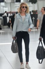 ROSIE HUNTINGTON-WHITELEY at Heathrow Airport in London 06/05/2015