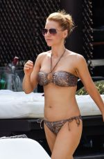 STEPHANIE WARING and JUDE CISSE in Bikinis at a Pool in Mmarbella