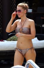 STEPHANIE WARING in Bikini at a Pool in Marbella 05/31/2015