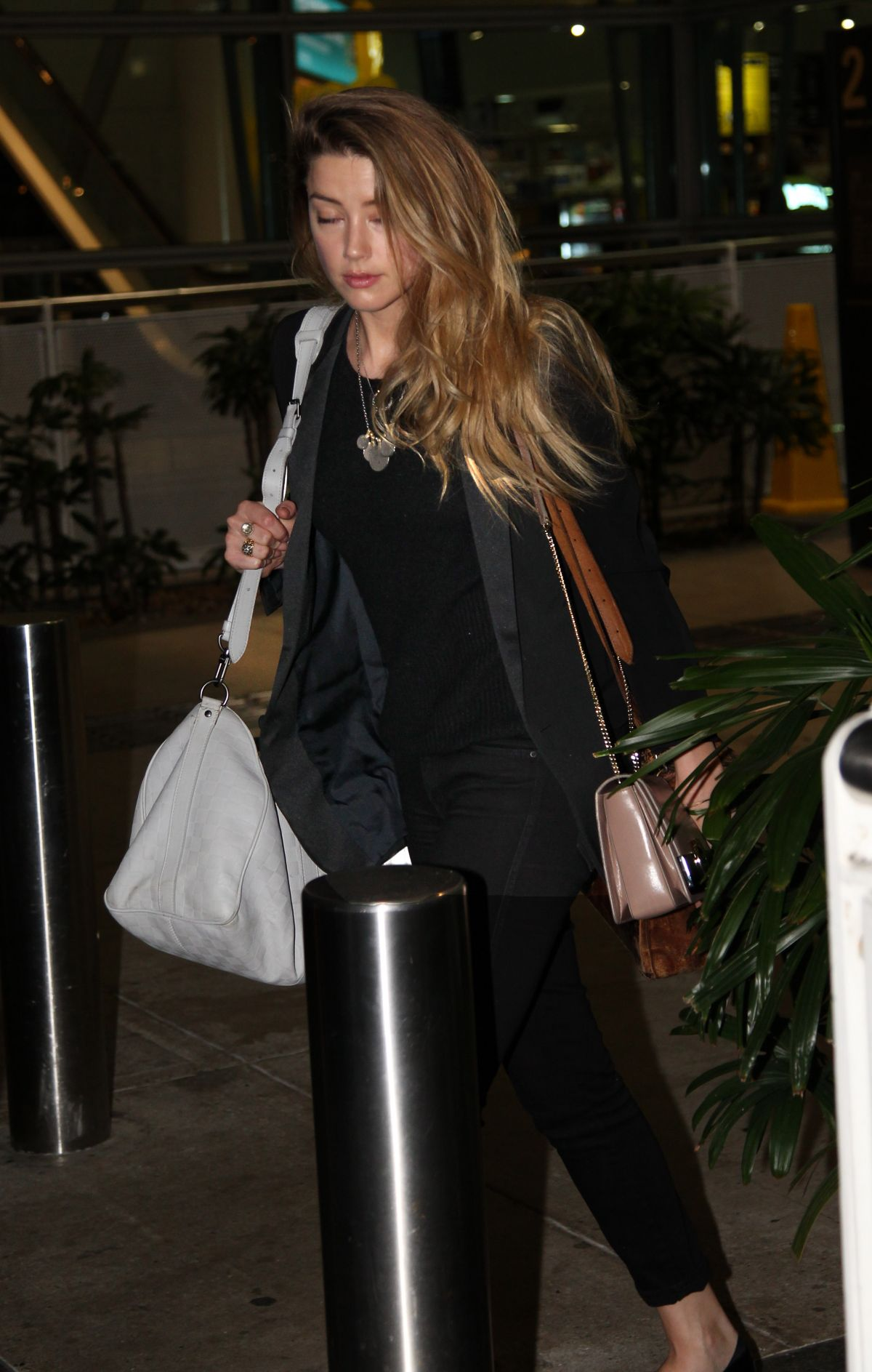 AMBERHEARD Arrives at Airport in Brisbane 07/09/2015