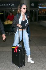 CARA DELEVINGNE in Jeans at LAX Airport inLos Angeles 07/07/2015