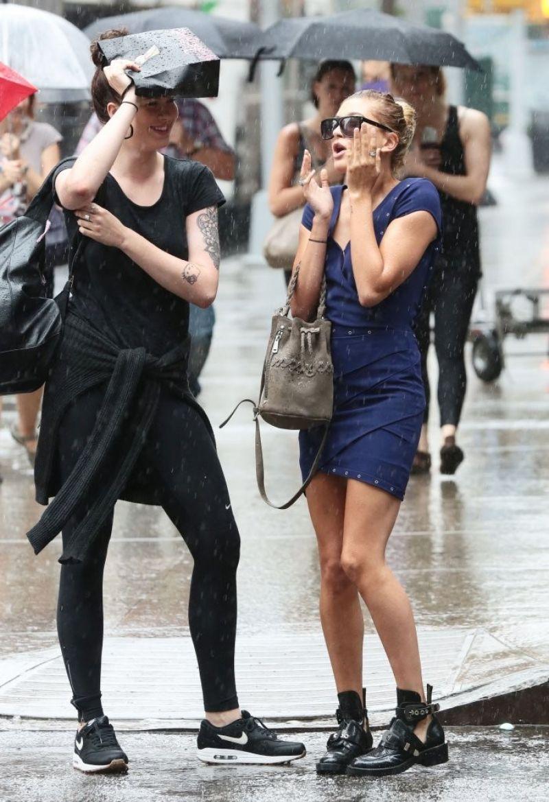 Hailey And Ireland Baldwin Caught In The Rain In New York