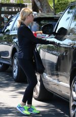 ASHLEY BENSON in tights Out And About in Los Angeles 08/13/2015