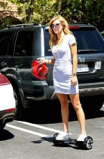 BELLA THORNE Riding Segway Out in Los Angeles 08/23/2015