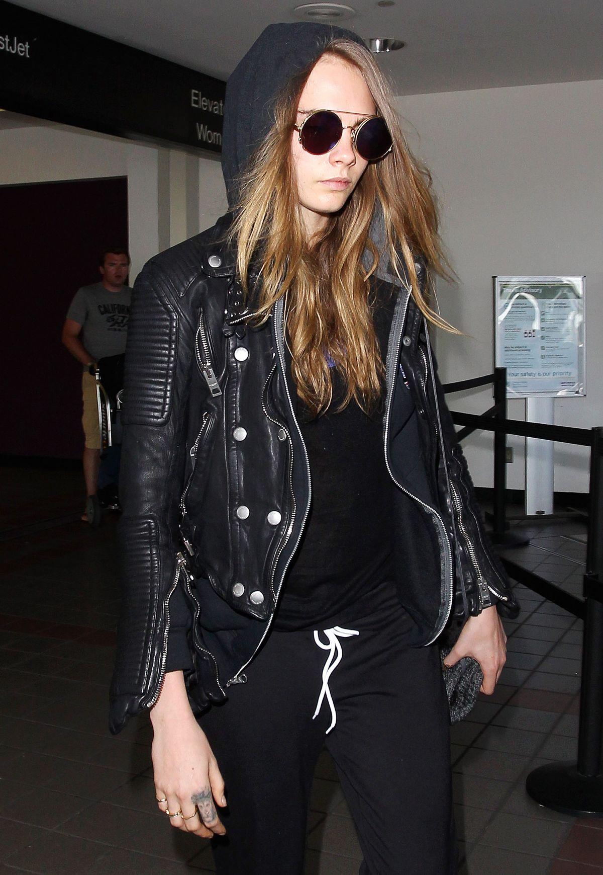 CARA DELEVINGNE Arrives at Los Angeles International Airport 08/28/2015
