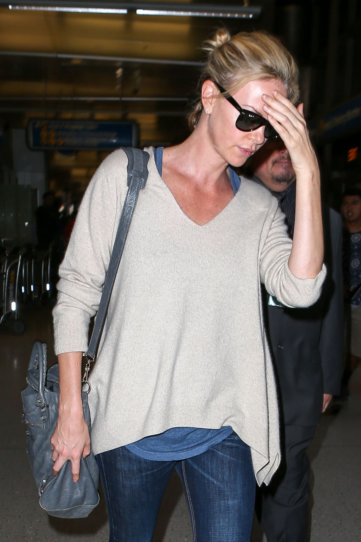 CHARLIZE THERON Arrives at Los Angeles International Airport 07/31/2015