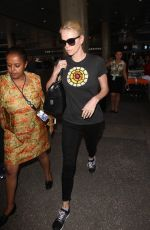 CHARLIZE THERON Arrives at Los Angeles International Airport 08/28/2015