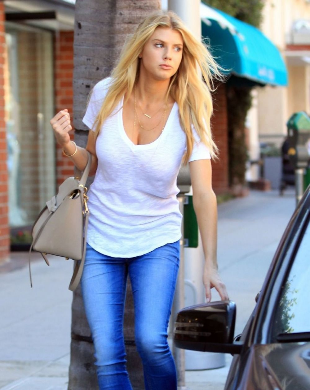 CHARLOTTE MCKINNEY in Jeans Out Shopping in Beverly Hills 08/04/2015