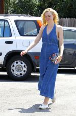 ELLE FANNING Out and About in Beverly Hills 08/22/2015