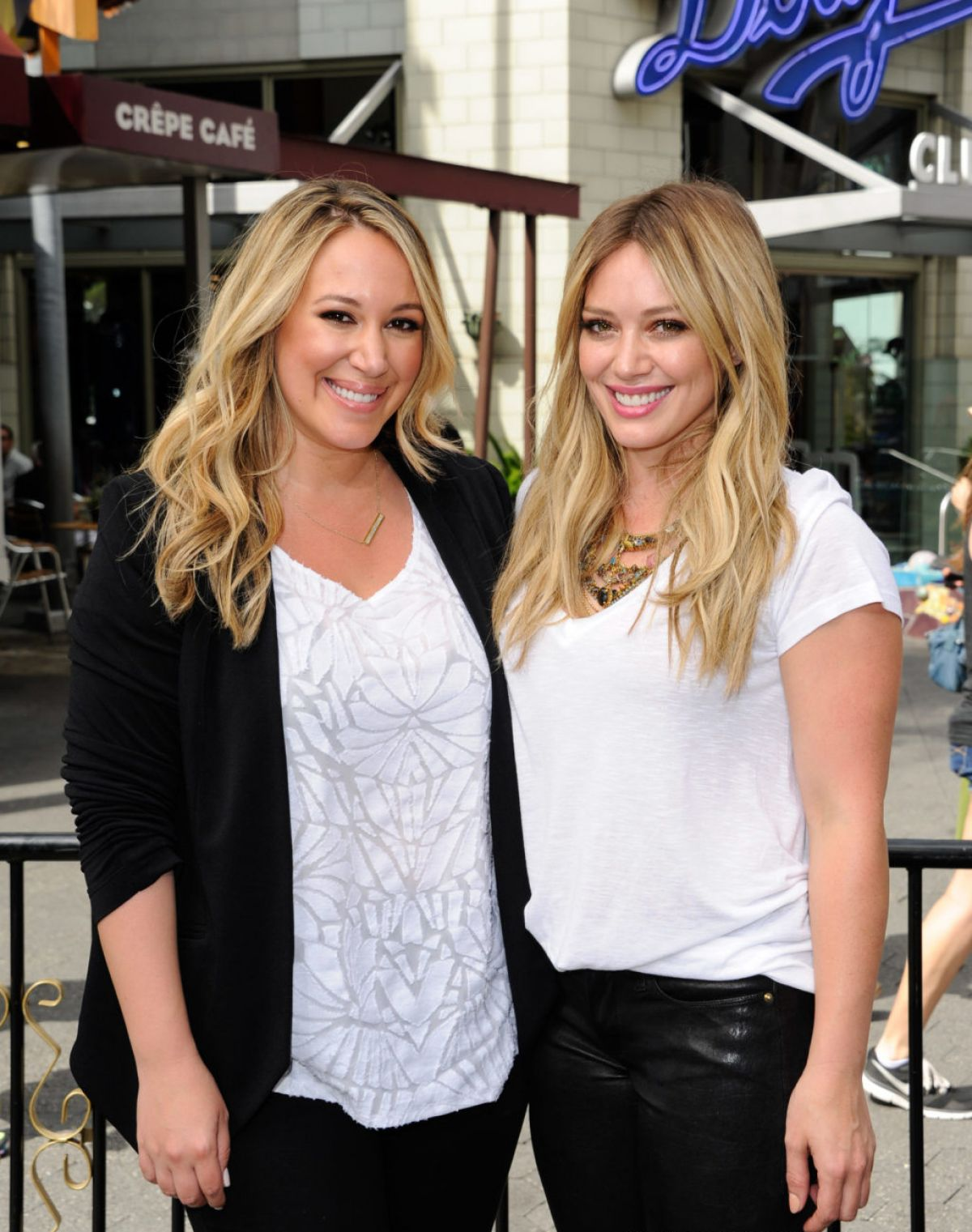 HILARY and HAYLIE DUFF in the Set of Extra - HawtCelebs