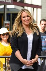 HILARY and HAYLIE DUFF in the Set of Extra