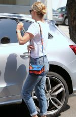 JANUARY JONES in Jeans Out in Beverly Hills 08/20/2015