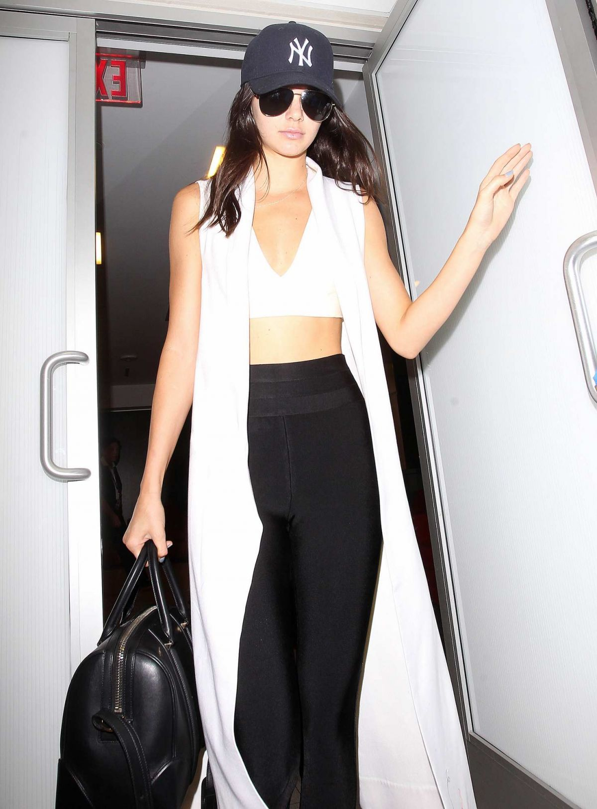 KENDALL JENNER Arrives at LAX Airport in Los Angeles 08/29/2015
