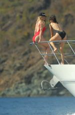 KHLOE KARDASHIAN and KENDALL JENNER inSwimsuits on a Boat in St. Barts 08/19/2015