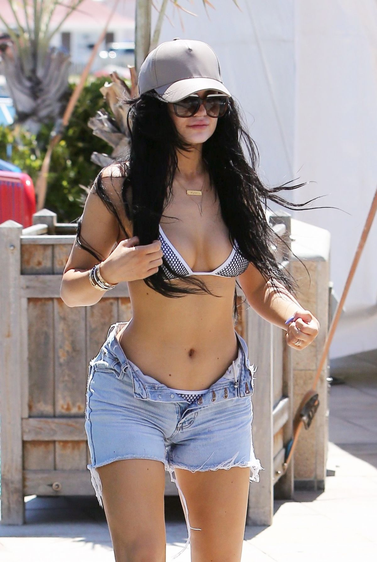 KYLIE JENNER in Bikini Top Arrives at a Boat
