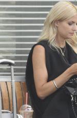 LENA GERCKE Enjoys a Smoke at a Train Station in Berlin 08/21/2015