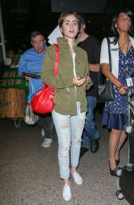 LILY COLLINS Arrives at LAX Airport in Los Angeles 08/12/2015