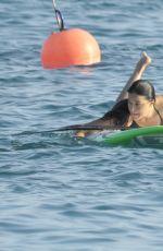 MICHELLE RODRIGUEZ in Bikini Paddleboarding in Sardinia 08/04/2015 (lq tag)