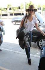 OLIVIA WILDE Arrives at LAX Airport in Los Angeles 08/20/2015