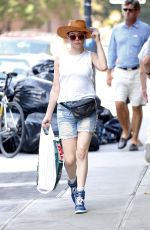ROSE MCGOWAN in Jeans Shorts Out Shopping in New York 03/08/2015