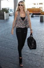 ROSIE HUNTINGTON-WHITELEY Arrives at Los Angeles International Airport 08/29/2015
